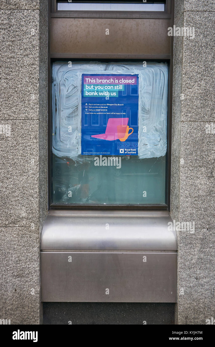Poster informing customers of Royal Bank of Scotland about a branch closure, Victoria Road, Glasgow, Scotland. - Stock Image