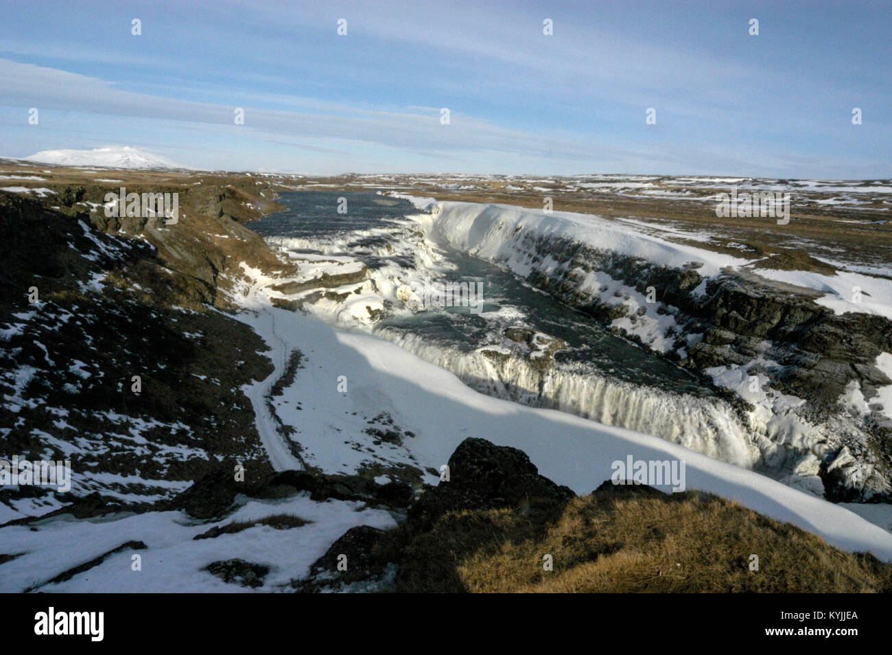 The snow-covered Gullfoss (Golden waterfalls) in southwest Iceland.   The falls has a drop of 32m into a narrow - Stock Image