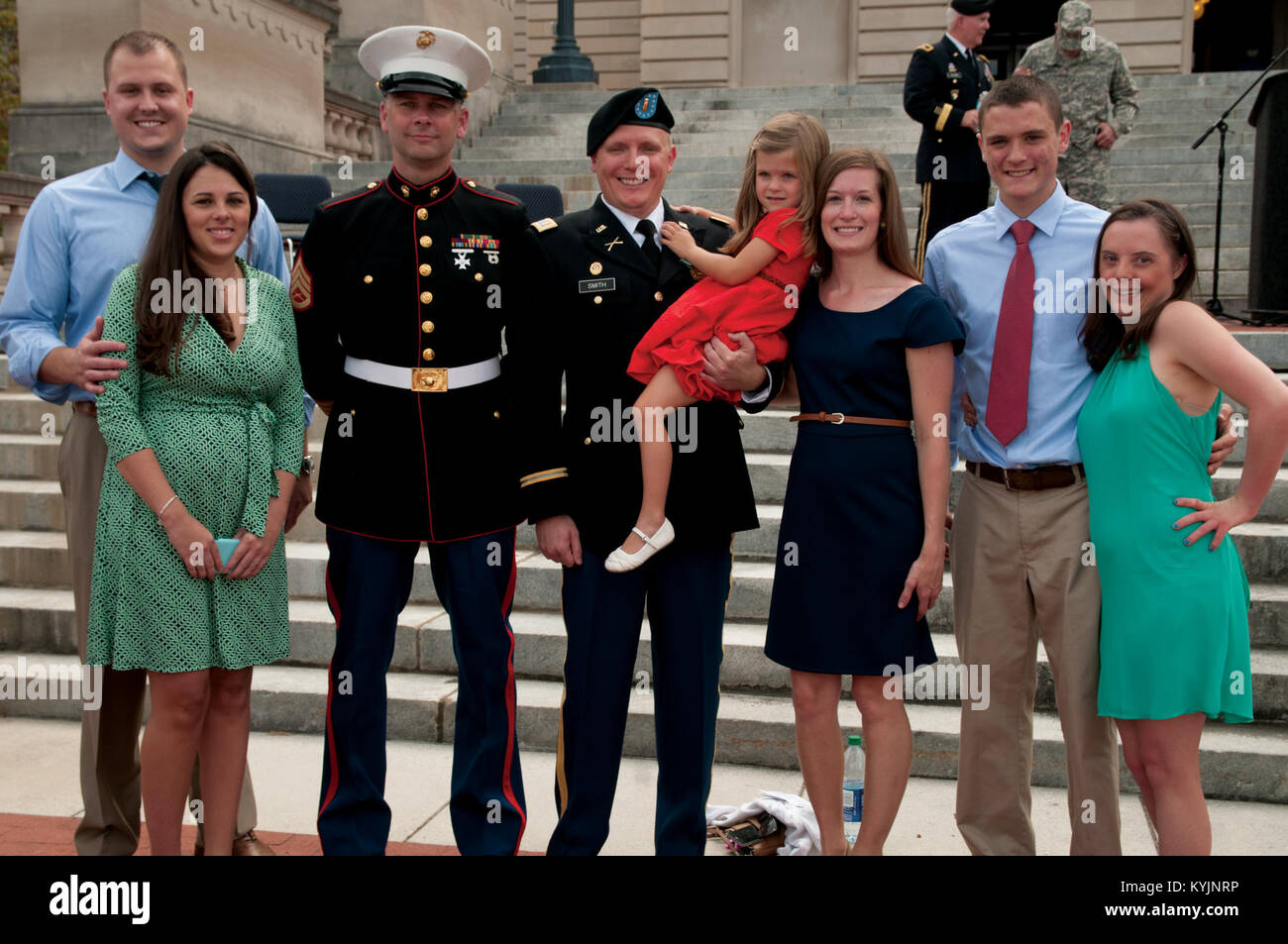 Newly promoted 2nd Lt. Benjamin R. Smith (center) poses with his family and friends after the completion of his - Stock Image