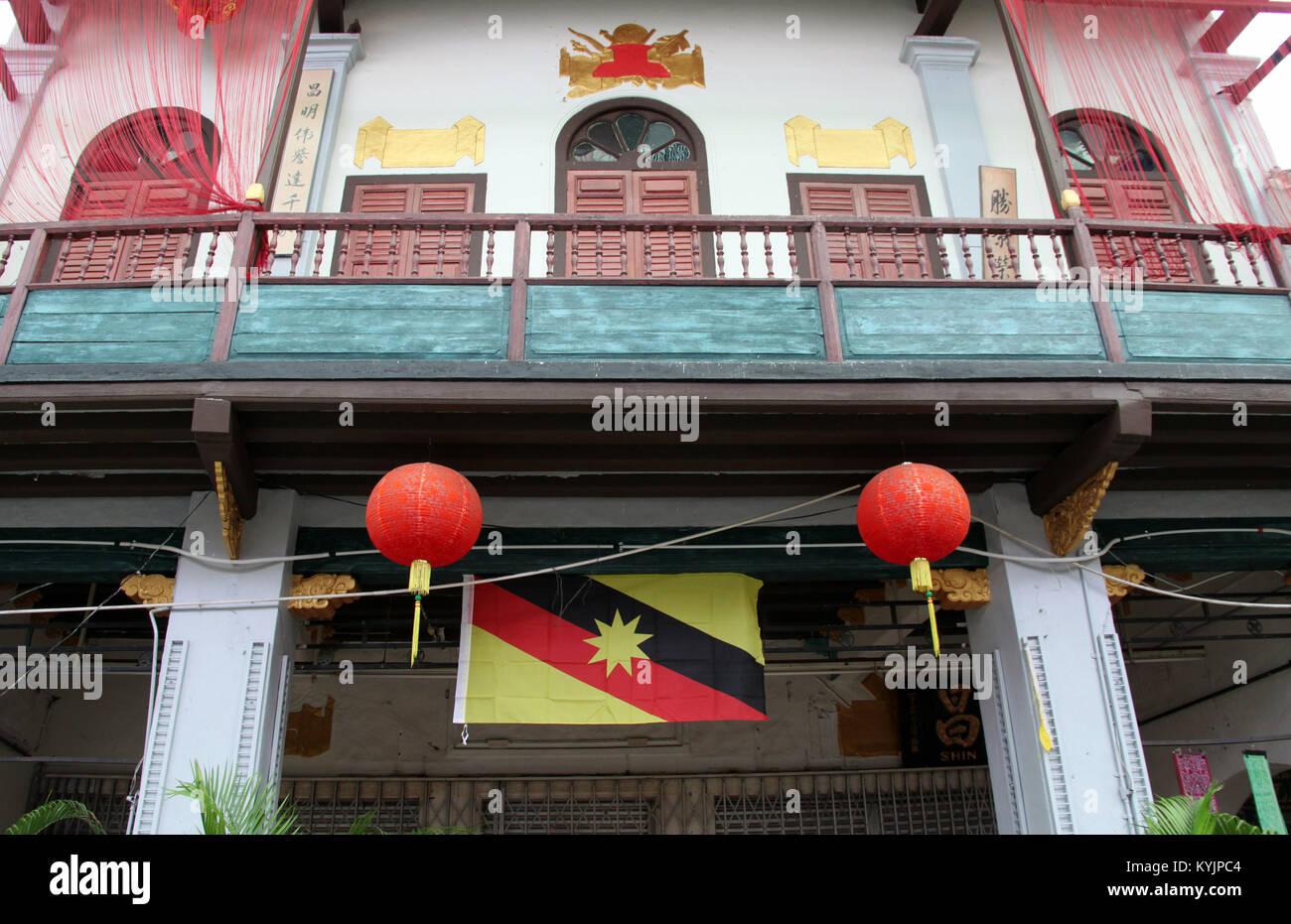 Kuching Shophouse and Sarawak Flag - Stock Image