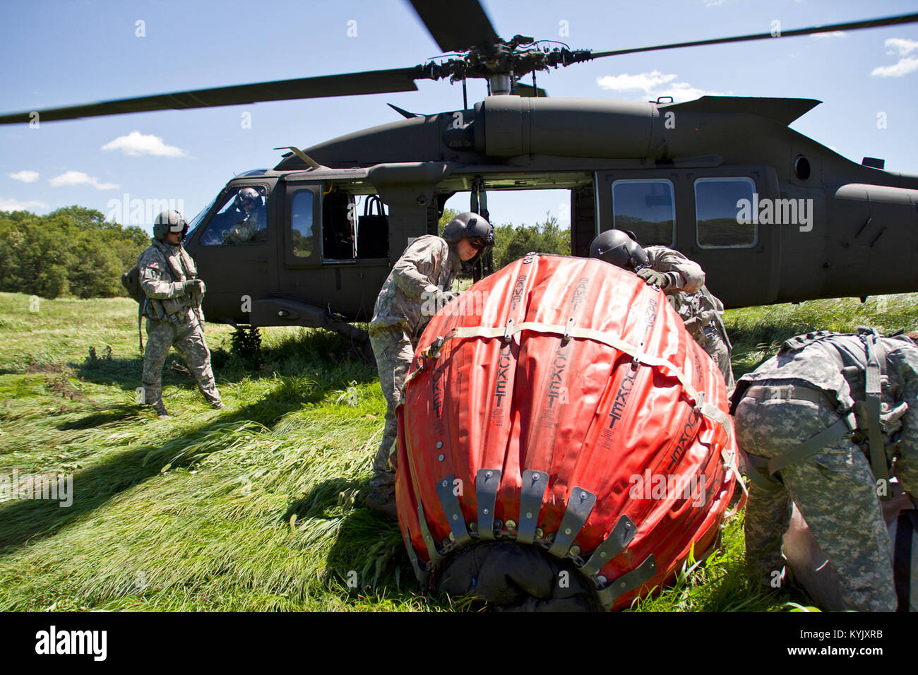 Soldiers with the 63rd Theater Aviation Brigade practice water drops