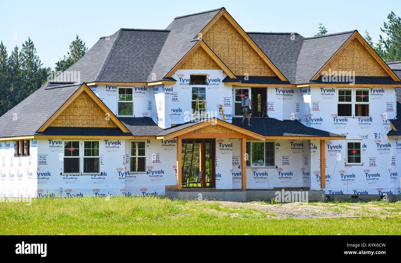 Large home under construction in the beautiful Pacific Northwest countryside of Bellingham, Washington, USA. A construction Stock Photo