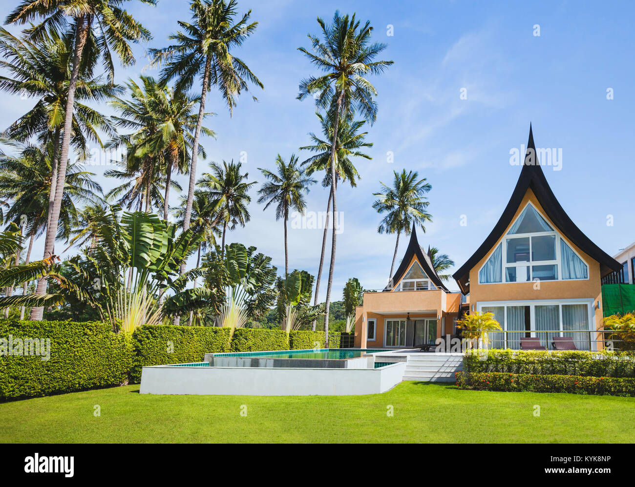 luxurious villa exterior, beautiful luxury vip house asian style with tropical swimming pool - Stock Image