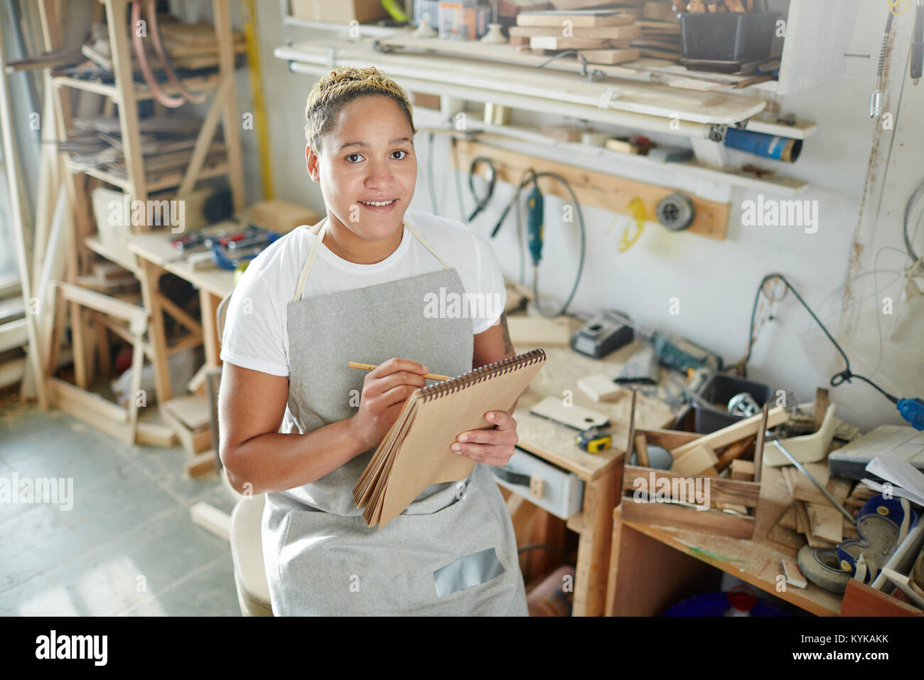 Carpenter with notepad - Stock Image