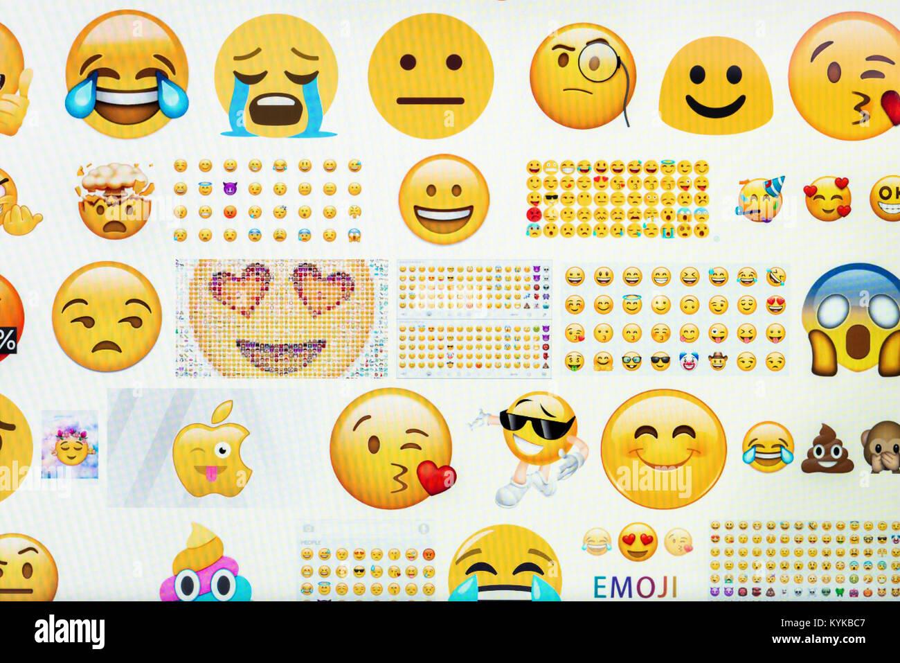 Emoji on computer screen. - Stock Image