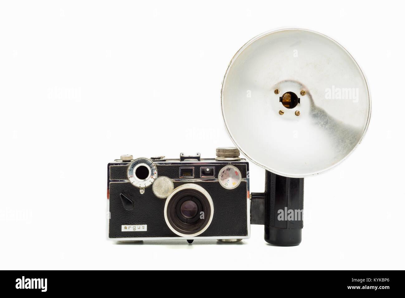Argus C3, 35mm film camera wit flash on white background - Stock Image