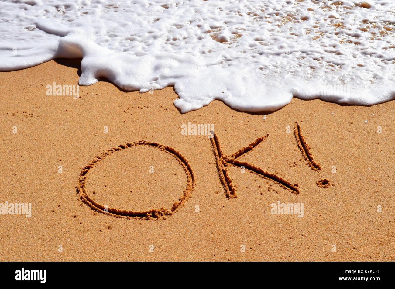Ok written in sand - Stock Image