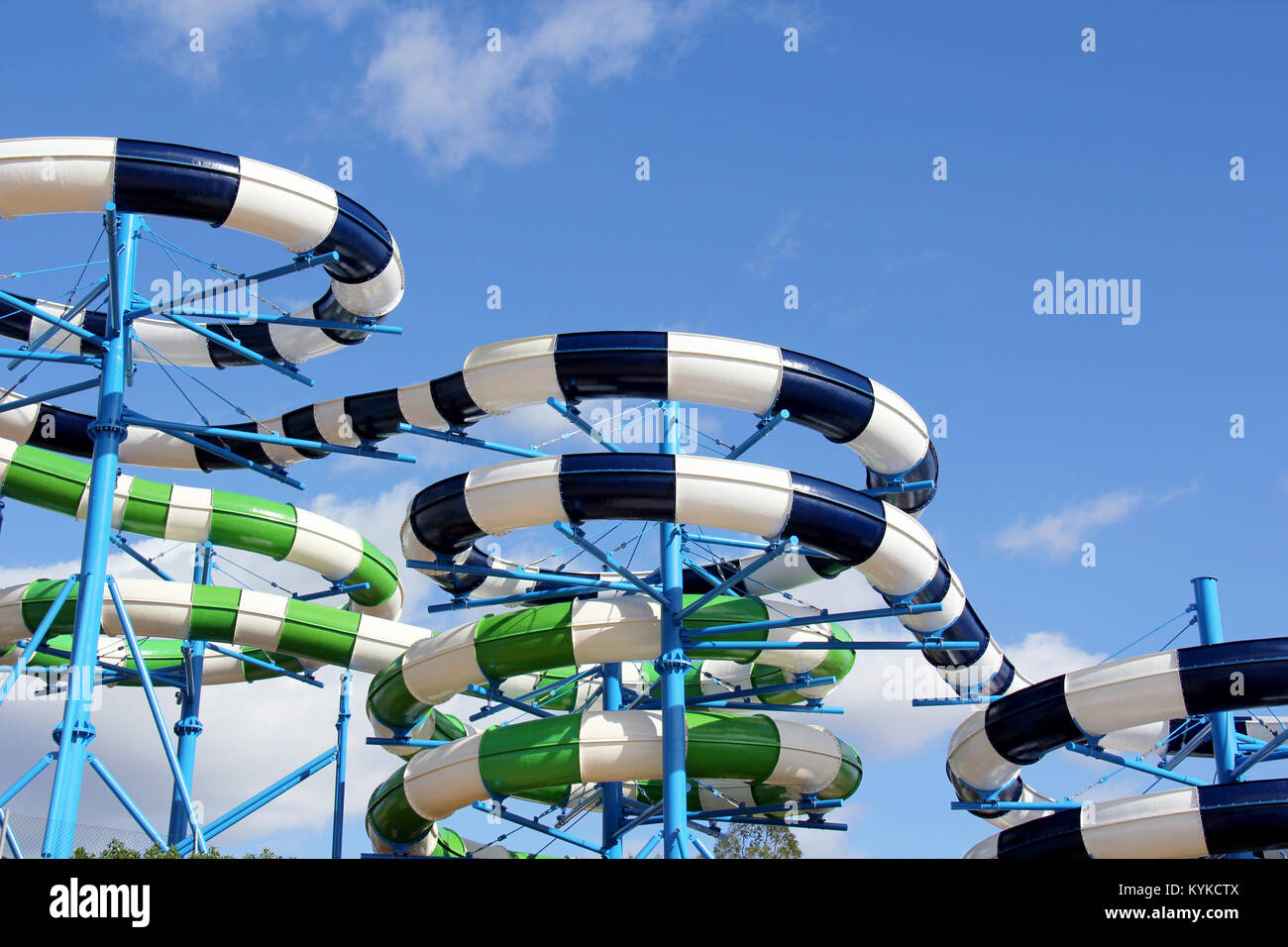 Brightly coloured slides in a water park in the Algarve Portugal. Stock Photo