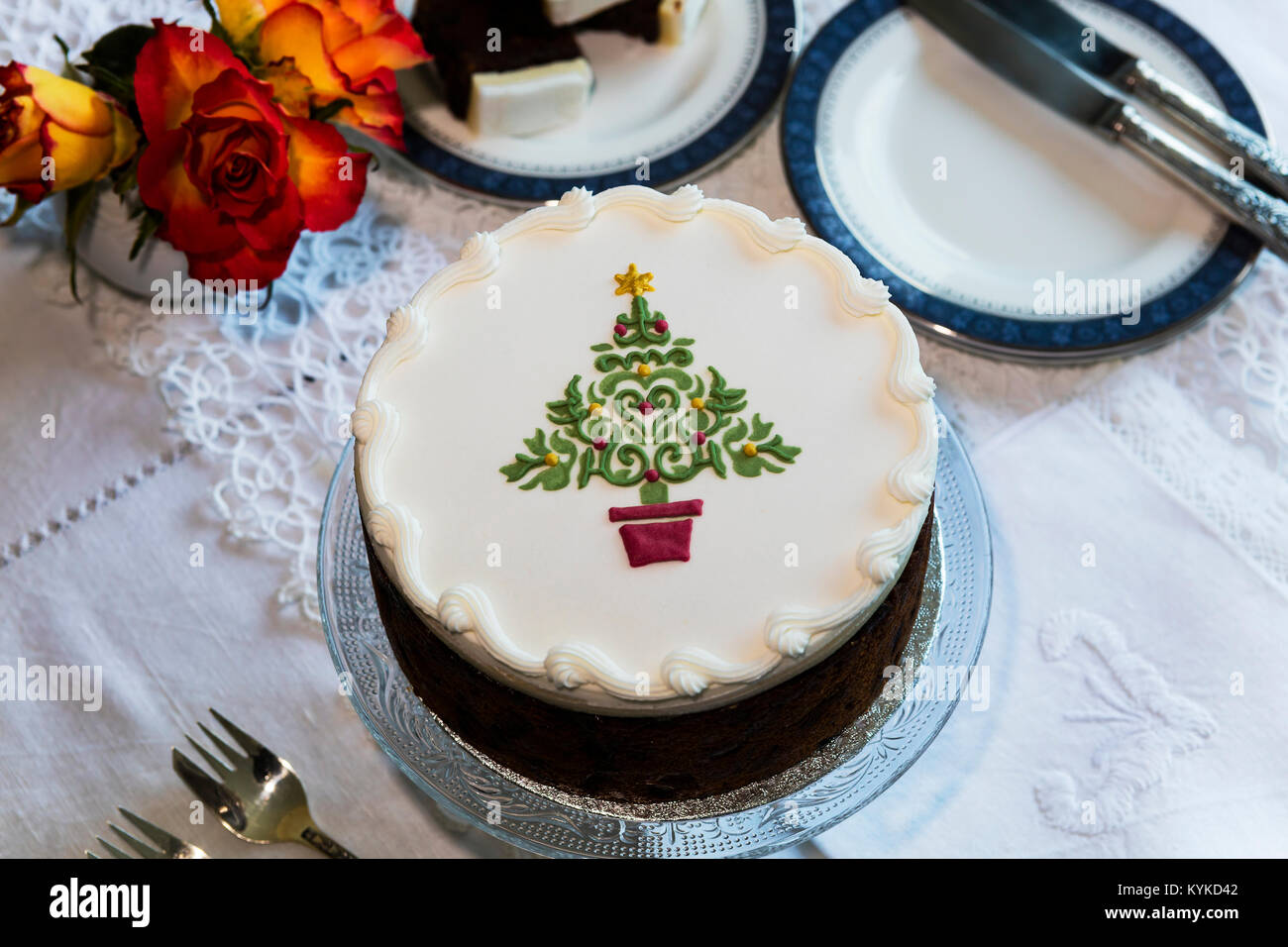 Fruit cake decorated on top with marzipan and royal icing and stencilled  Christmas Tree. - Stock Image