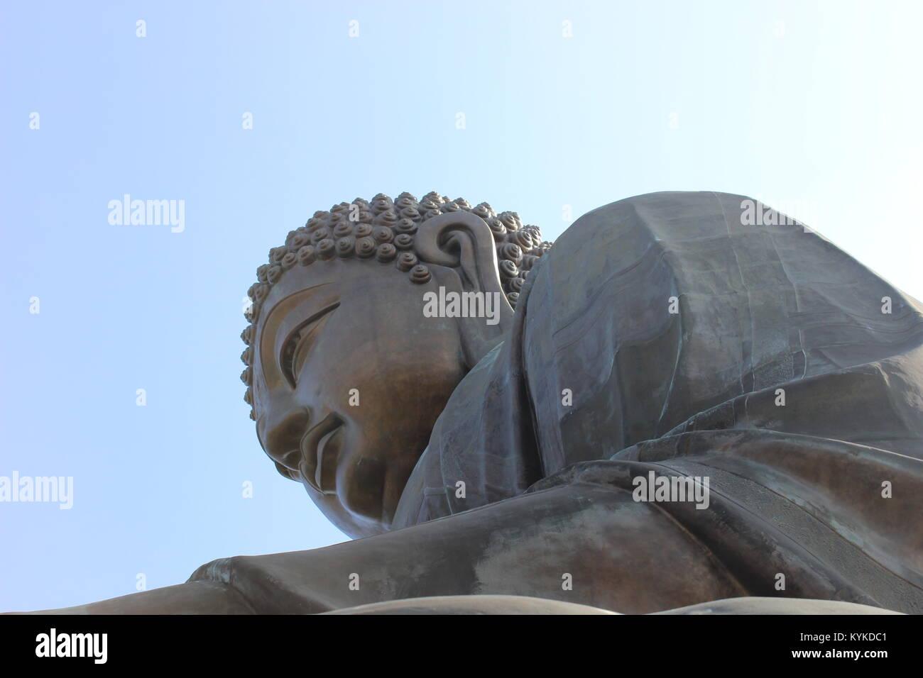 Big Buddha on Lantau Island, Hong Kong. Basking in the sunshine - Stock Image