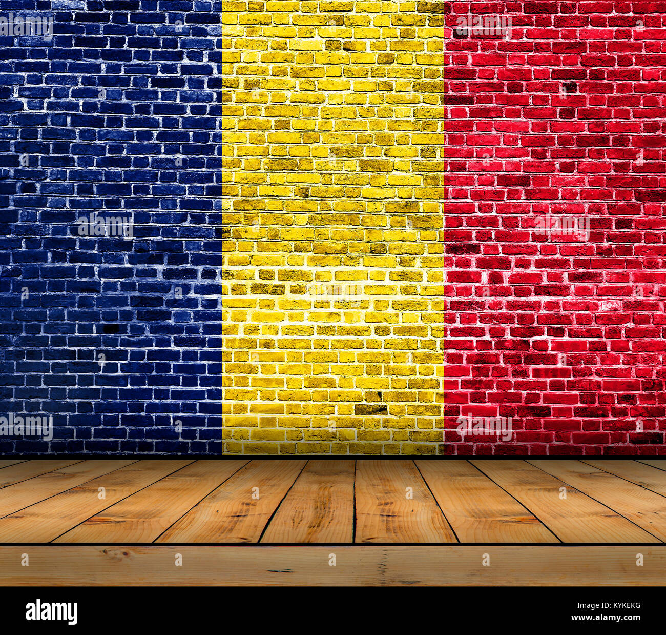 Chad flag painted on brick wall with wooden floor - Stock Image