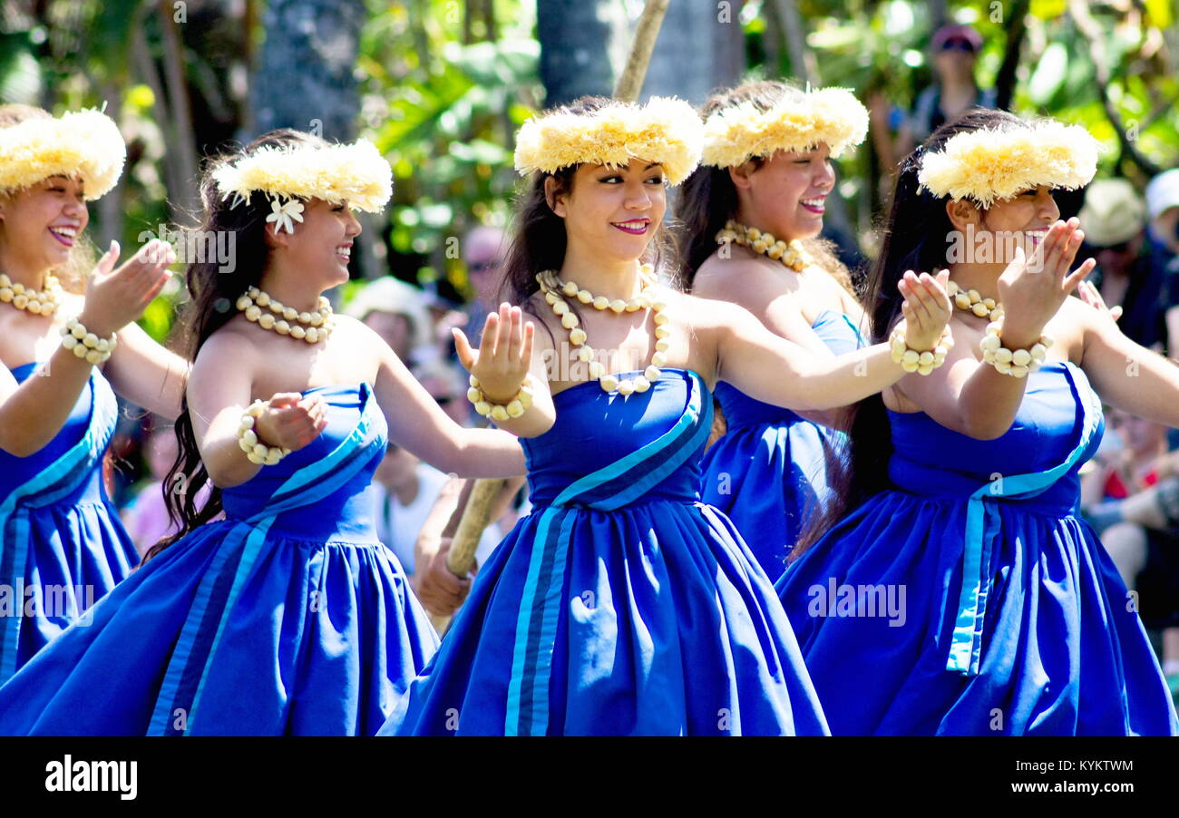 Oahu, Hawaii - May 27, 2016: Hawaiian dancers on a canoe float at the Polynesian Cultural Center, a popular tourist - Stock Image