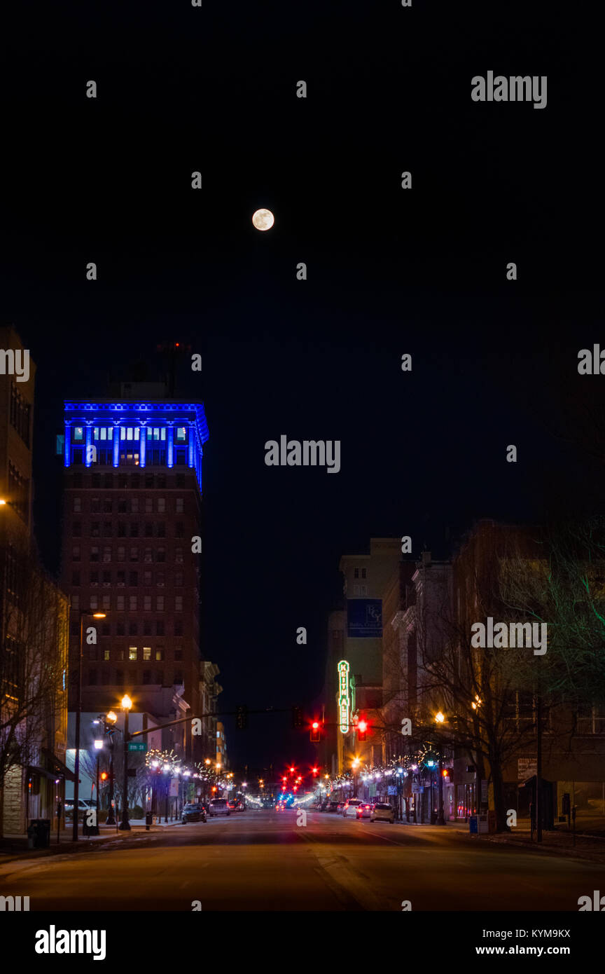 The first full moon of 2018 rises above the city of Huntington, West Virginia looking down town 4th Avenue. Stock Photo