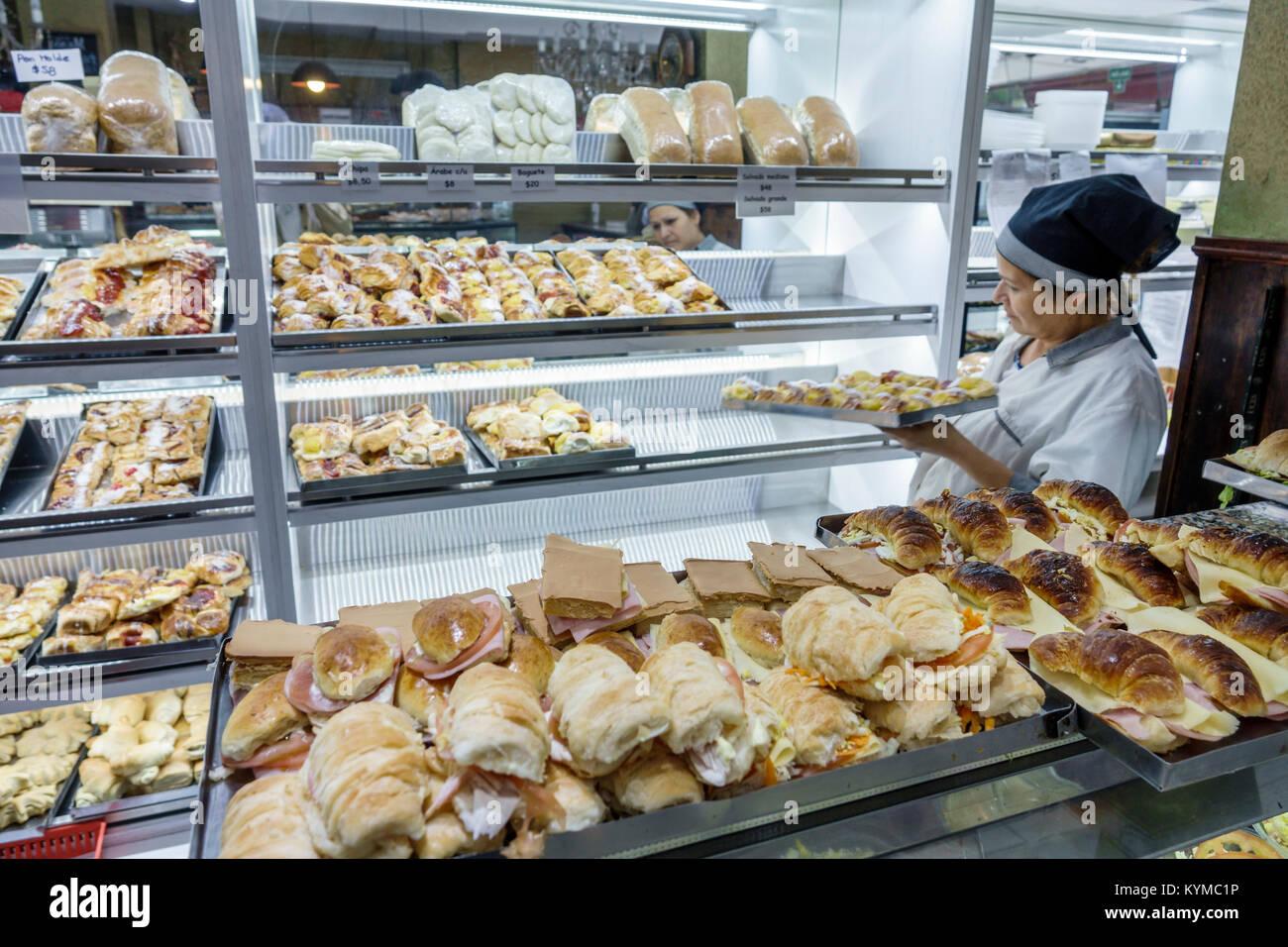 Buenos Aires Argentina Palermo Santa Elena pasteleria bakery interior Hispanic woman counter worker baked goods - Stock Image