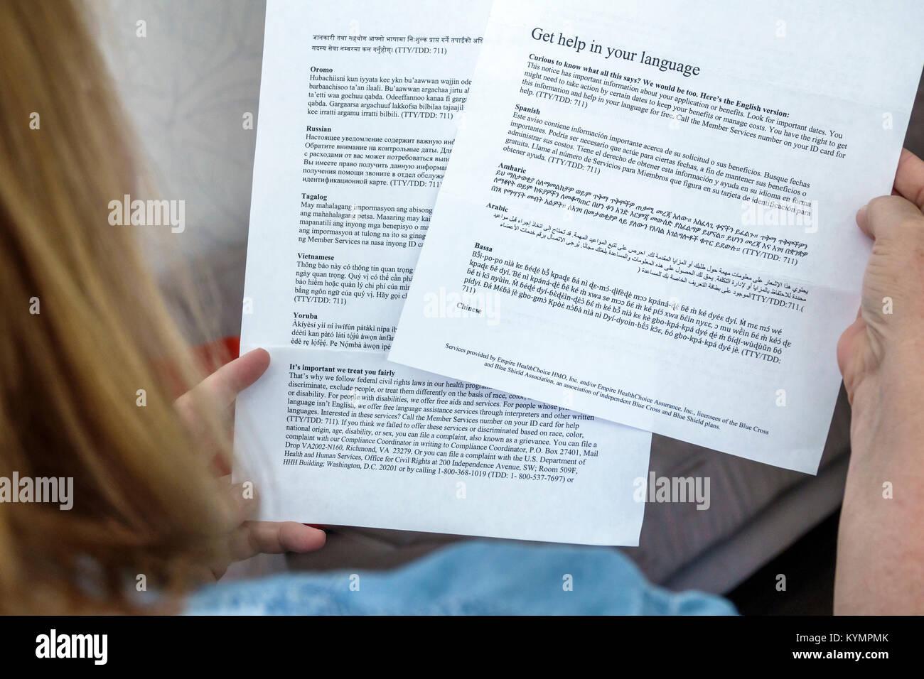 Miami Beach Florida policy documents insurance Empire HealthChoice HMO medical multilingual languages English Spanish - Stock Image
