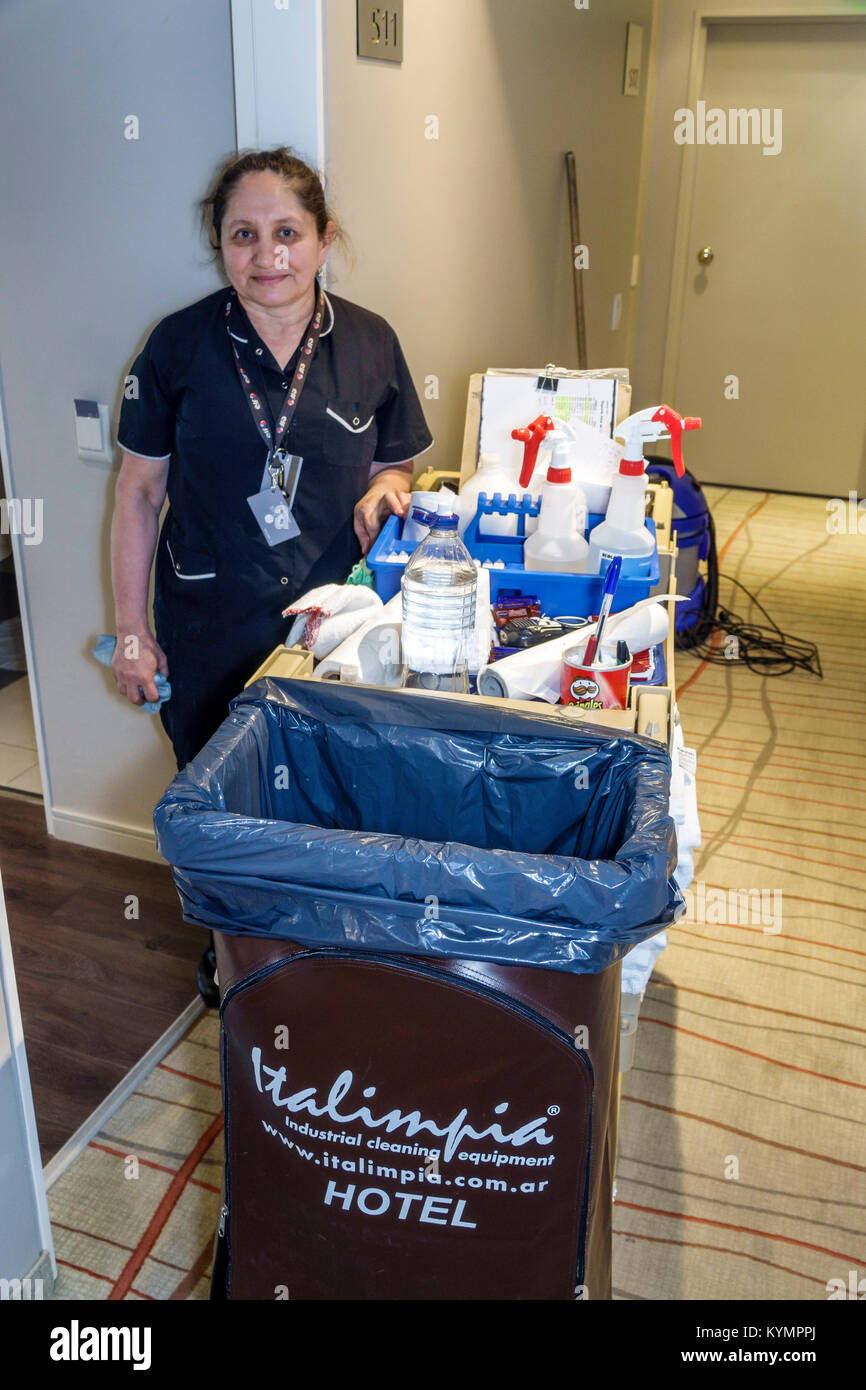 Buenos Aires Argentina Palermo Dazzler Polo hotel hallway housekeeper maid cart Hispanic woman job Argentinean Argentinian Stock Photo