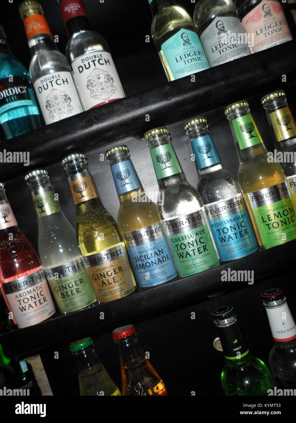 Selection of flavoured Tonic Waters on a shelf in an English pub, Durham, England. - Stock Image