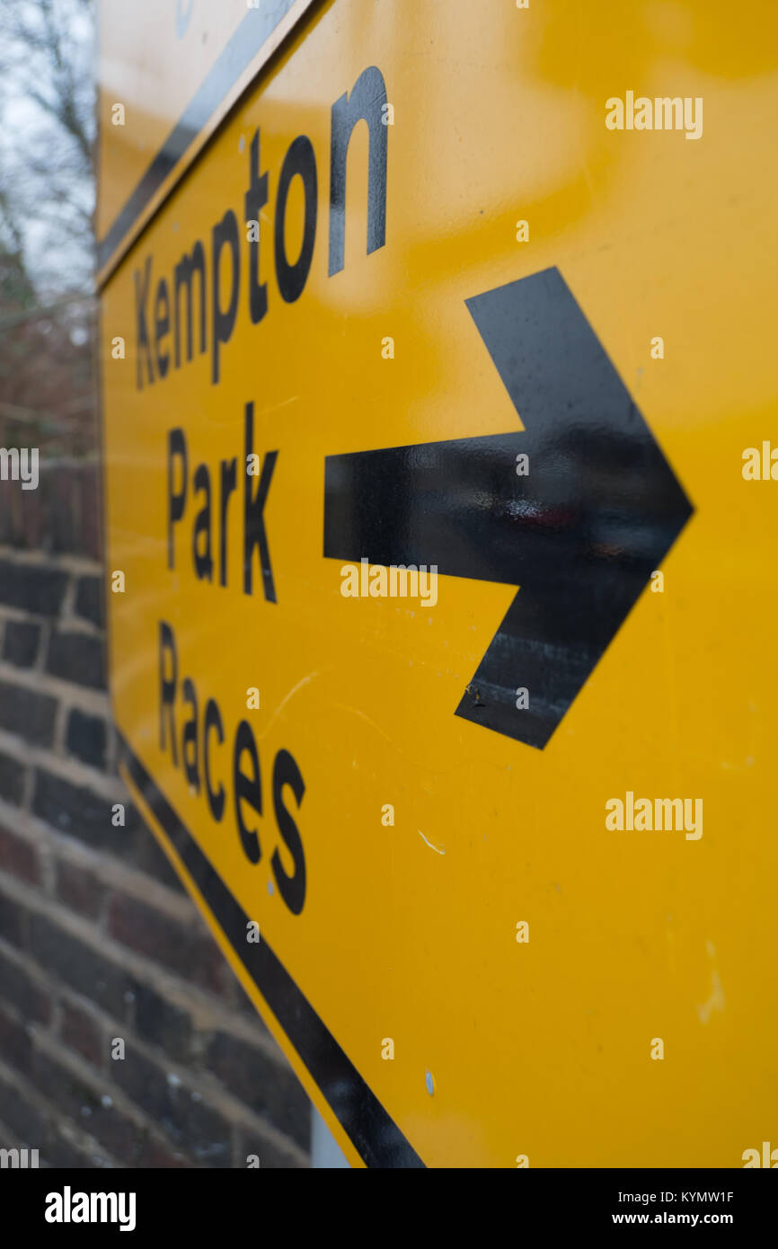 temporary road sign giving directions, with a right pointing arrow, to kempton park races - Stock Image