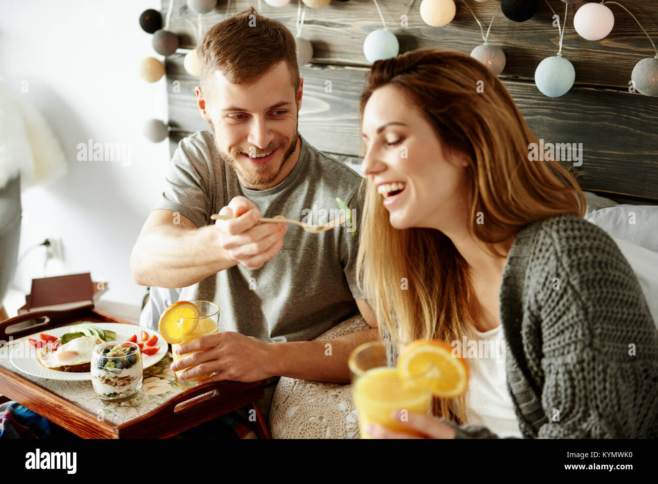 Man sharing breakfast with woman - Stock Image