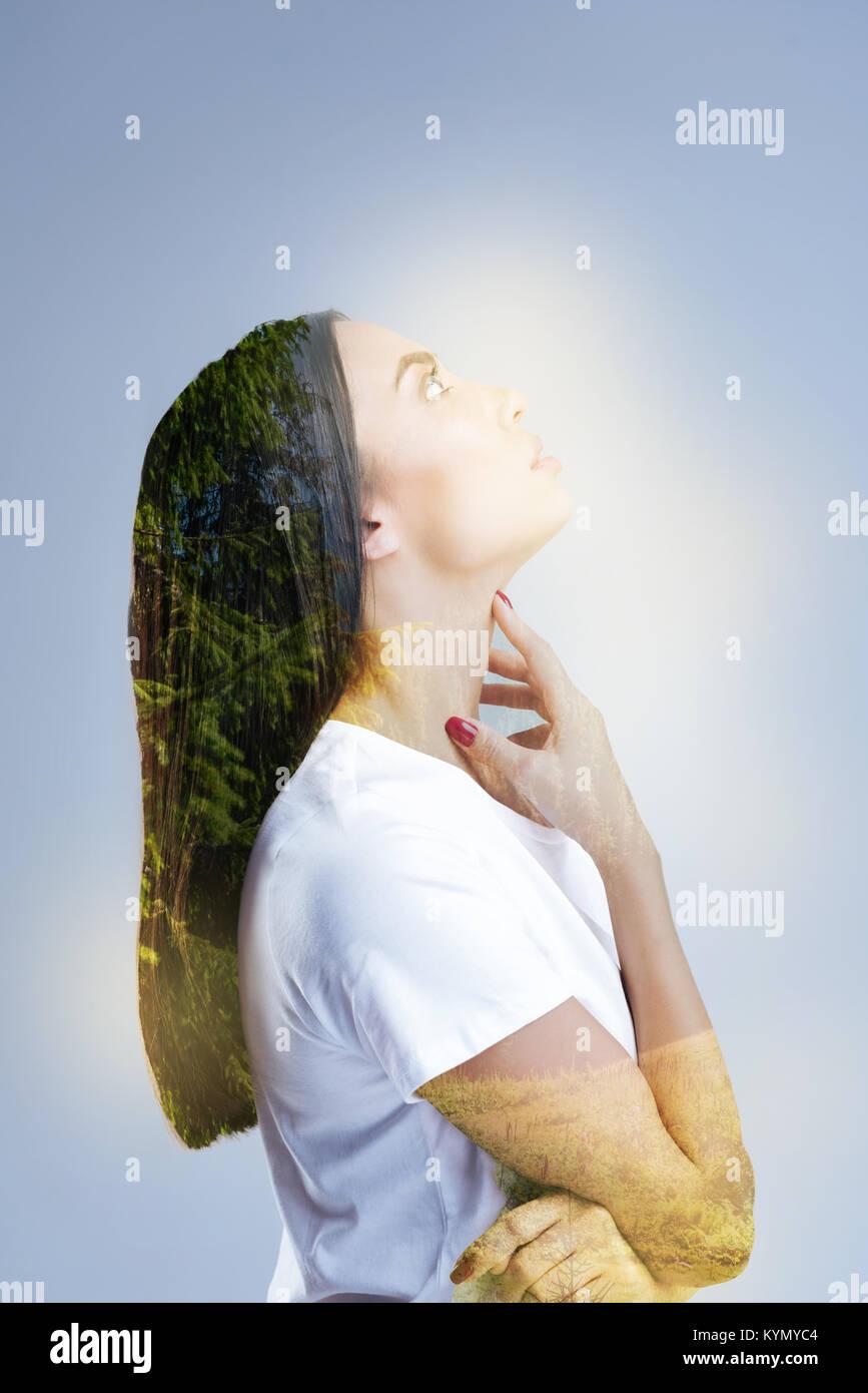 Inspired beautiful woman letting go her imaginatio - Stock Image