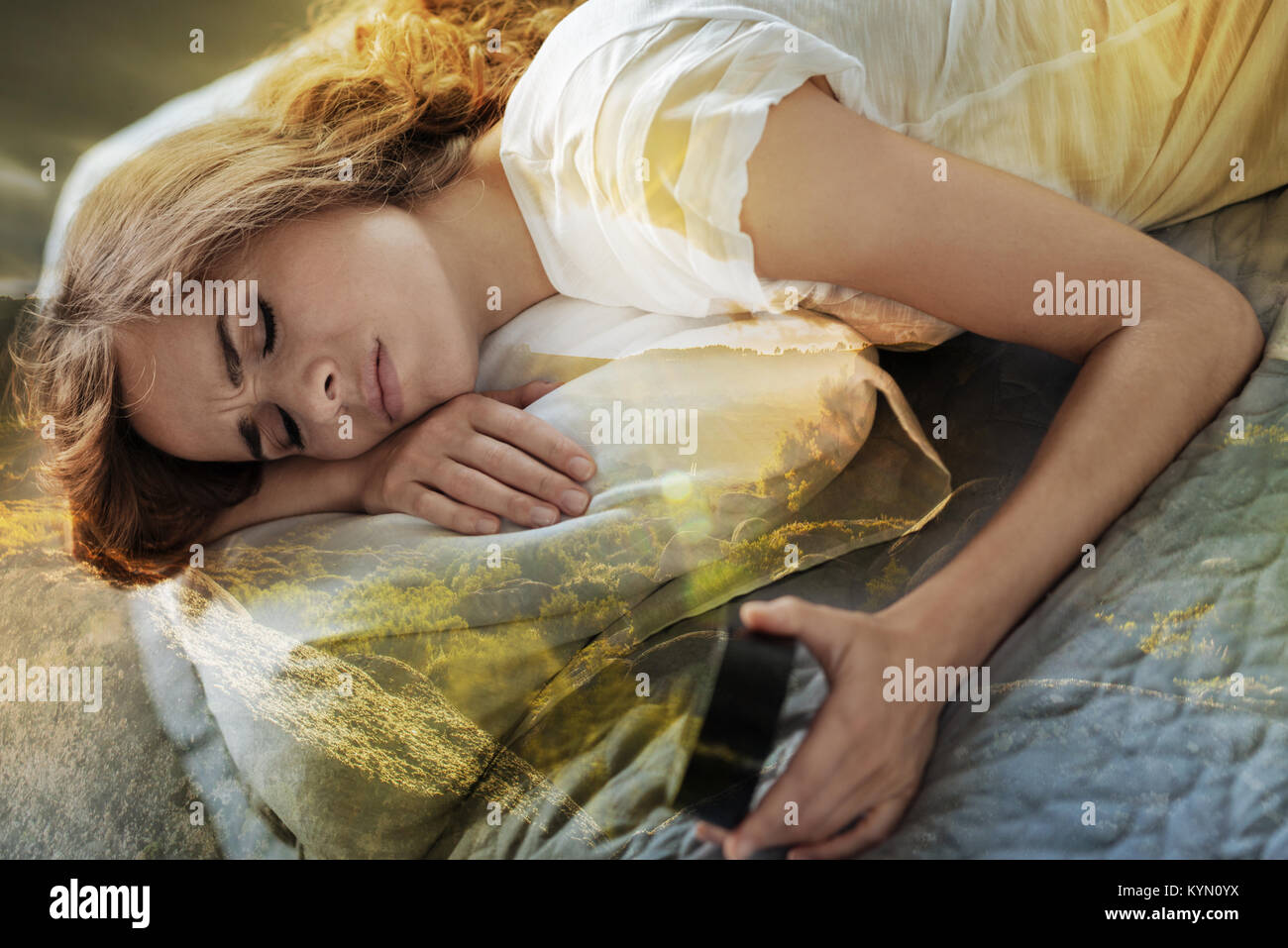 Tired girl sleeping on her bed - Stock Image