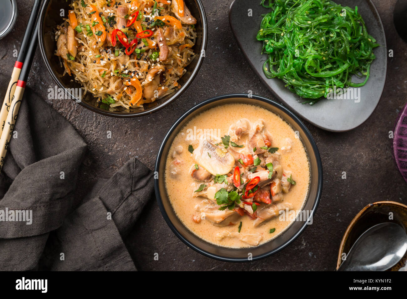 Spicy soup with coconut milk and chicken thai food called tom kha spicy soup with coconut milk and chicken thai food called tom kha gai on black table top view forumfinder Image collections