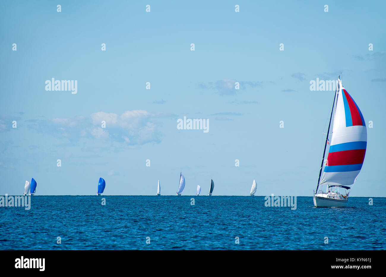 sailboats with spinnakers in summer regatta on Lake Michigan - Stock Image