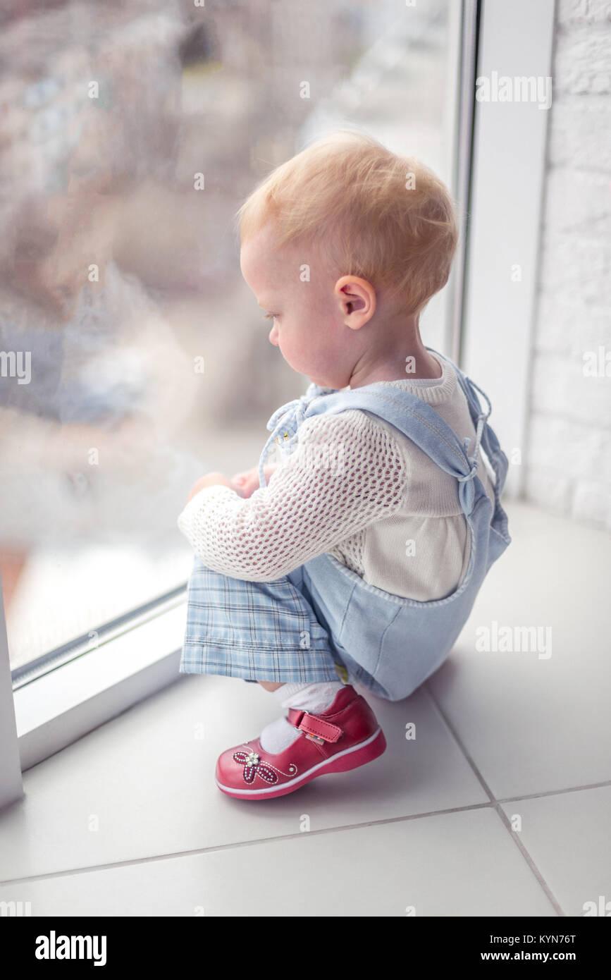 Nice babe at the big window Stock Photo