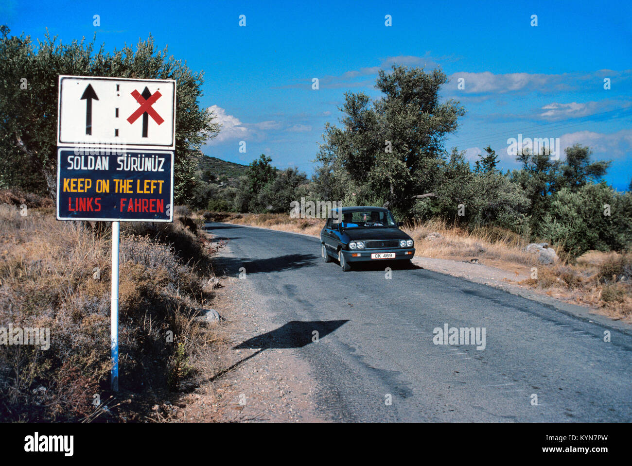 Keep Left, Drive on the Left, or Left Hand Drive Road Sign, Northern Cyprus - Stock Image