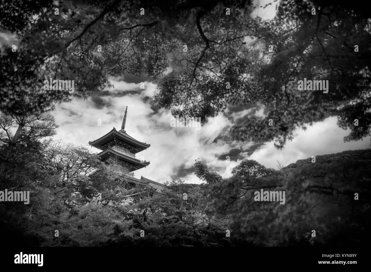 Dramatic artistic black and white photograph of sanjunoto pagoda of kiyomizu dera buddhist temple in kyoto japan in a beautiful scenery behind japane