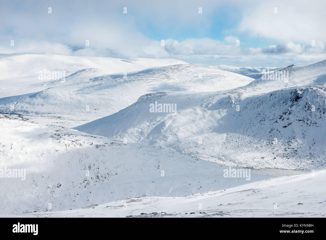 Looking east from Cairn Gorm mountain across the wilderness of the snow covered Cairngorm mountain range - Stock Image