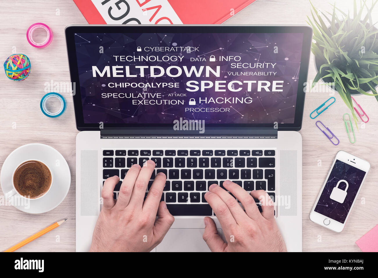 Meltdown and spectre threat concept on top view laptop screen with mans hands on office desk. - Stock Image