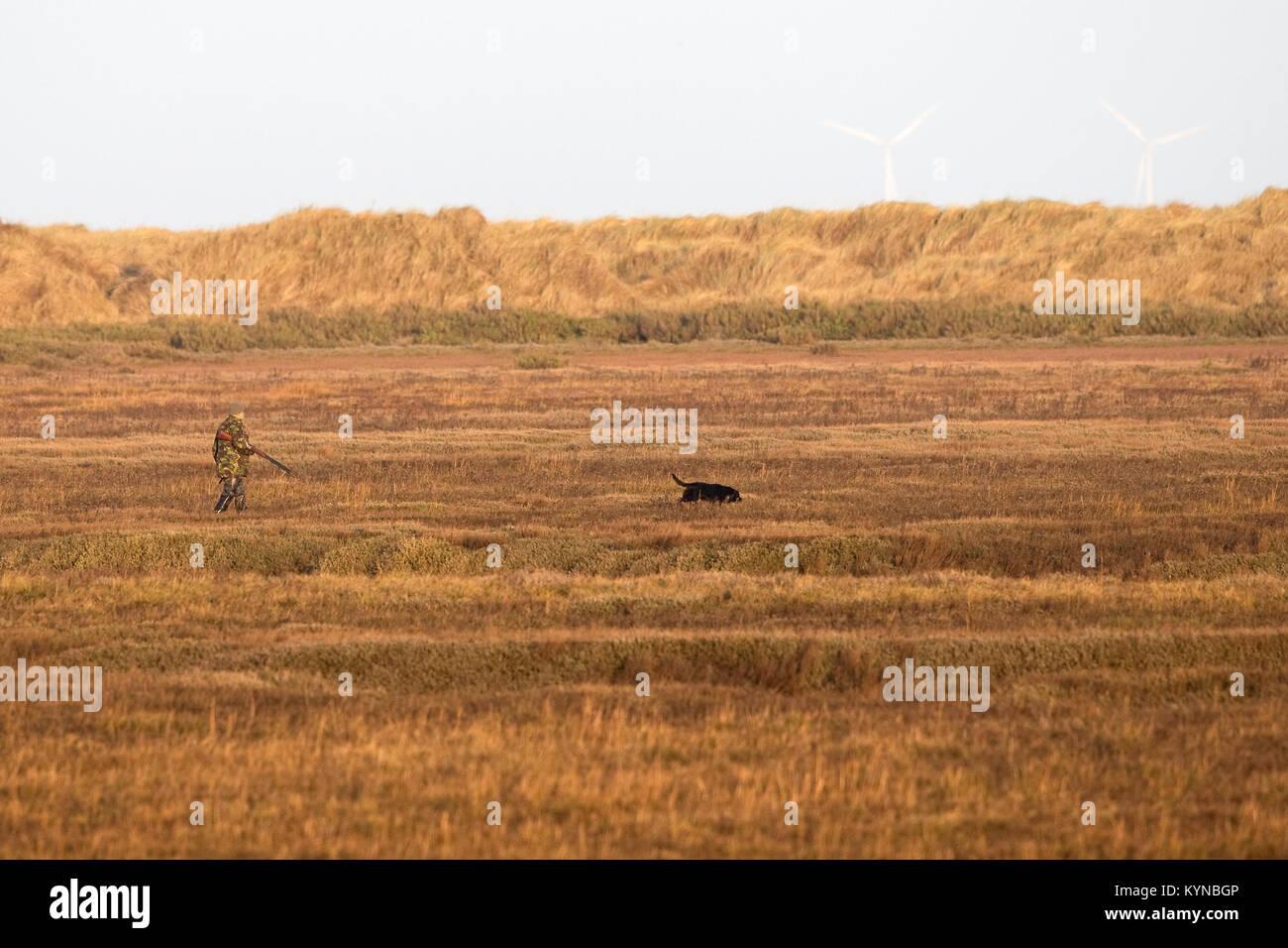 Hunter & dog Stock Photo