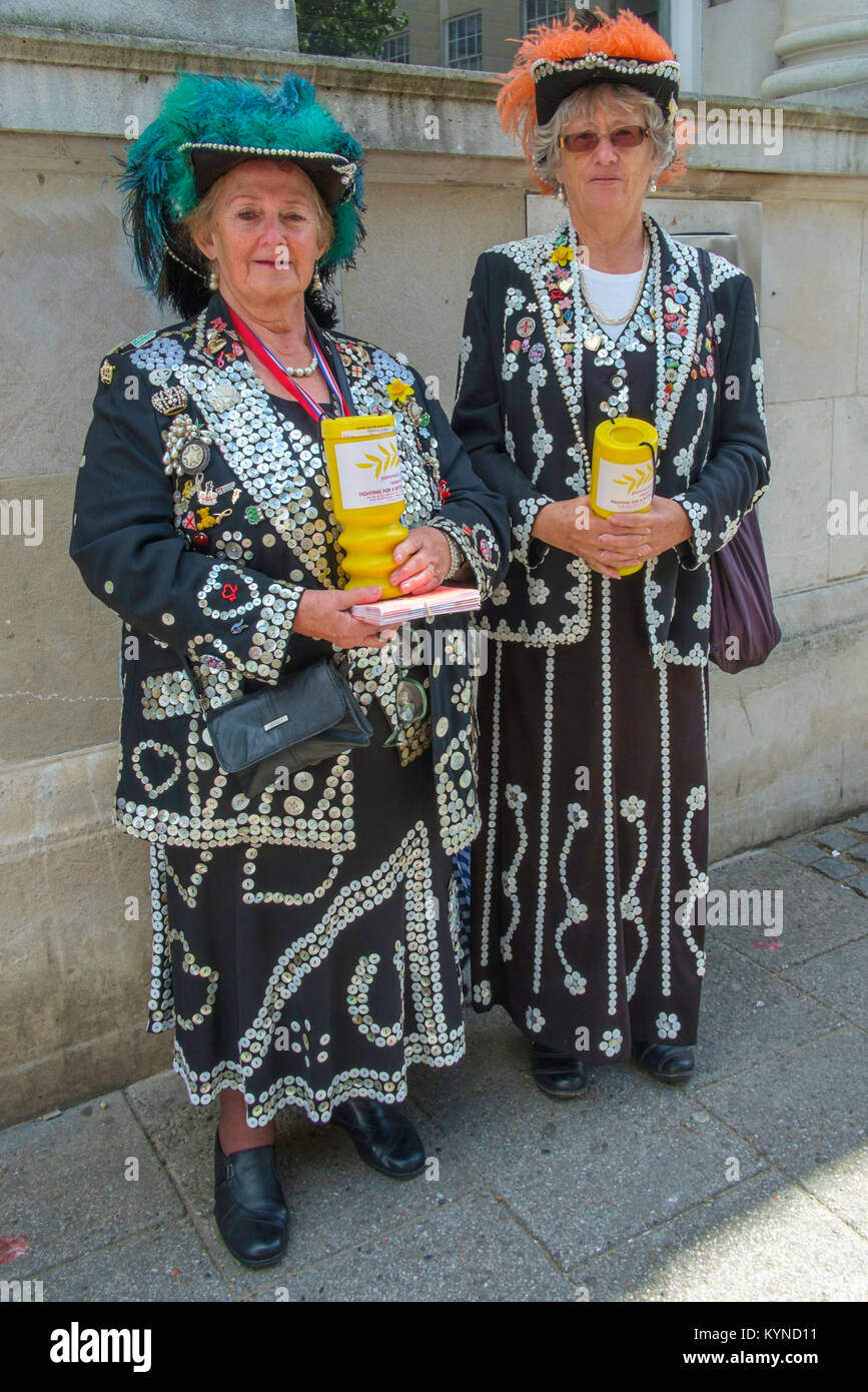 Two Pearly Queens collecting money for charity in town centre in Ramsgate, Kent. - Stock Image