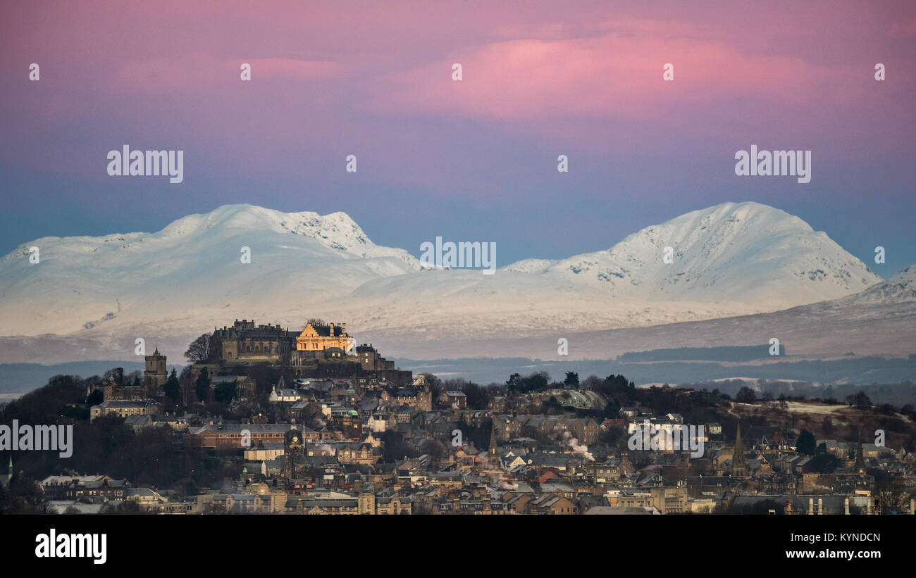 Stirling Castle in a wintery Scotland day just before sunrise hits the castle - Stock Image