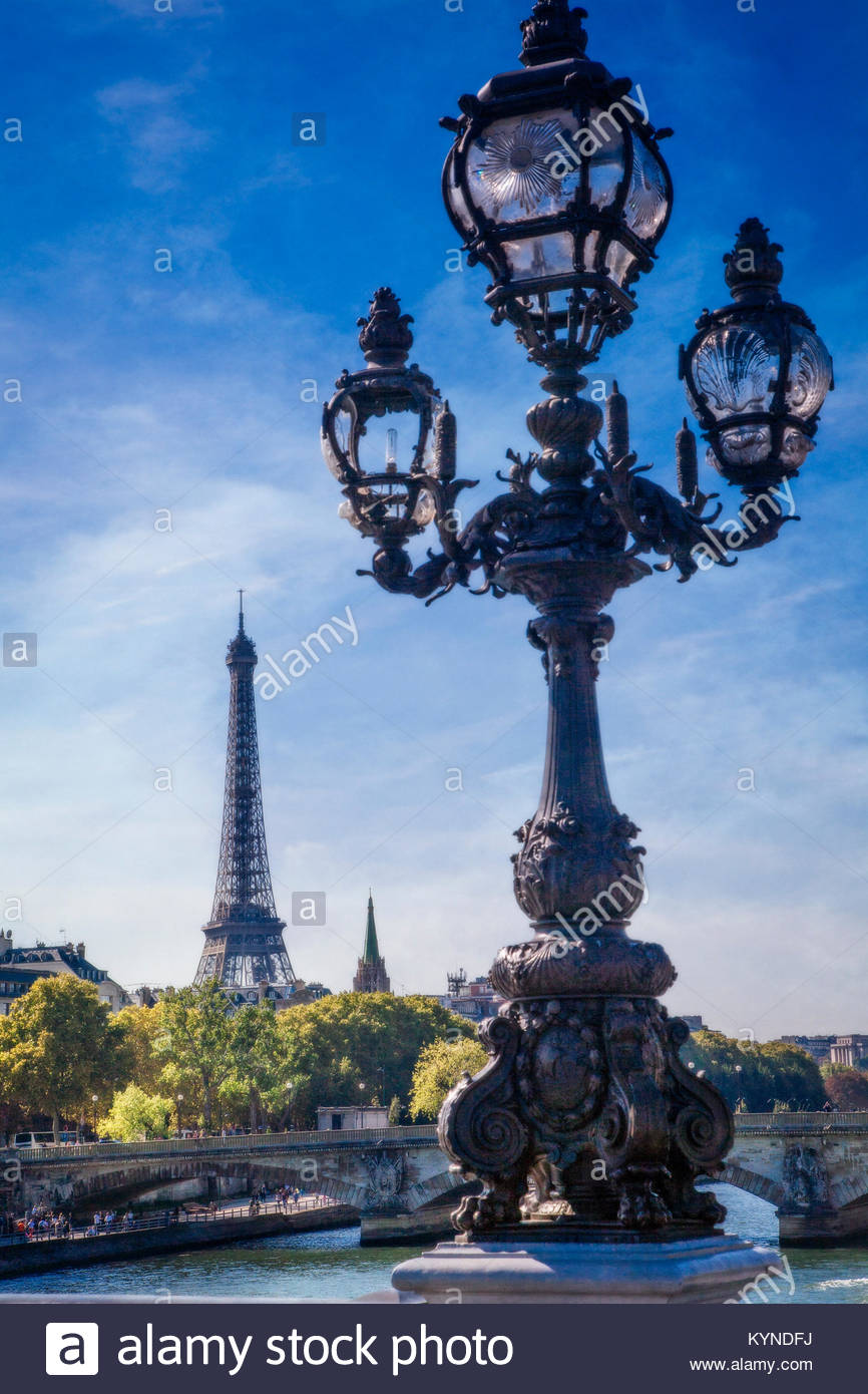 The Pont Alexandre III bridge with the Eiffel Tower rising in the background.  Paris, France. - Stock Image