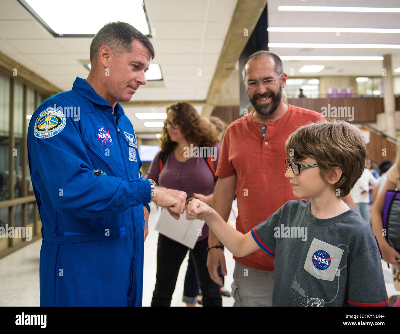 NASA astronaut Shane Kimbrough gives Nikola a fist bump after a presentation about his time onboard the International - Stock Image