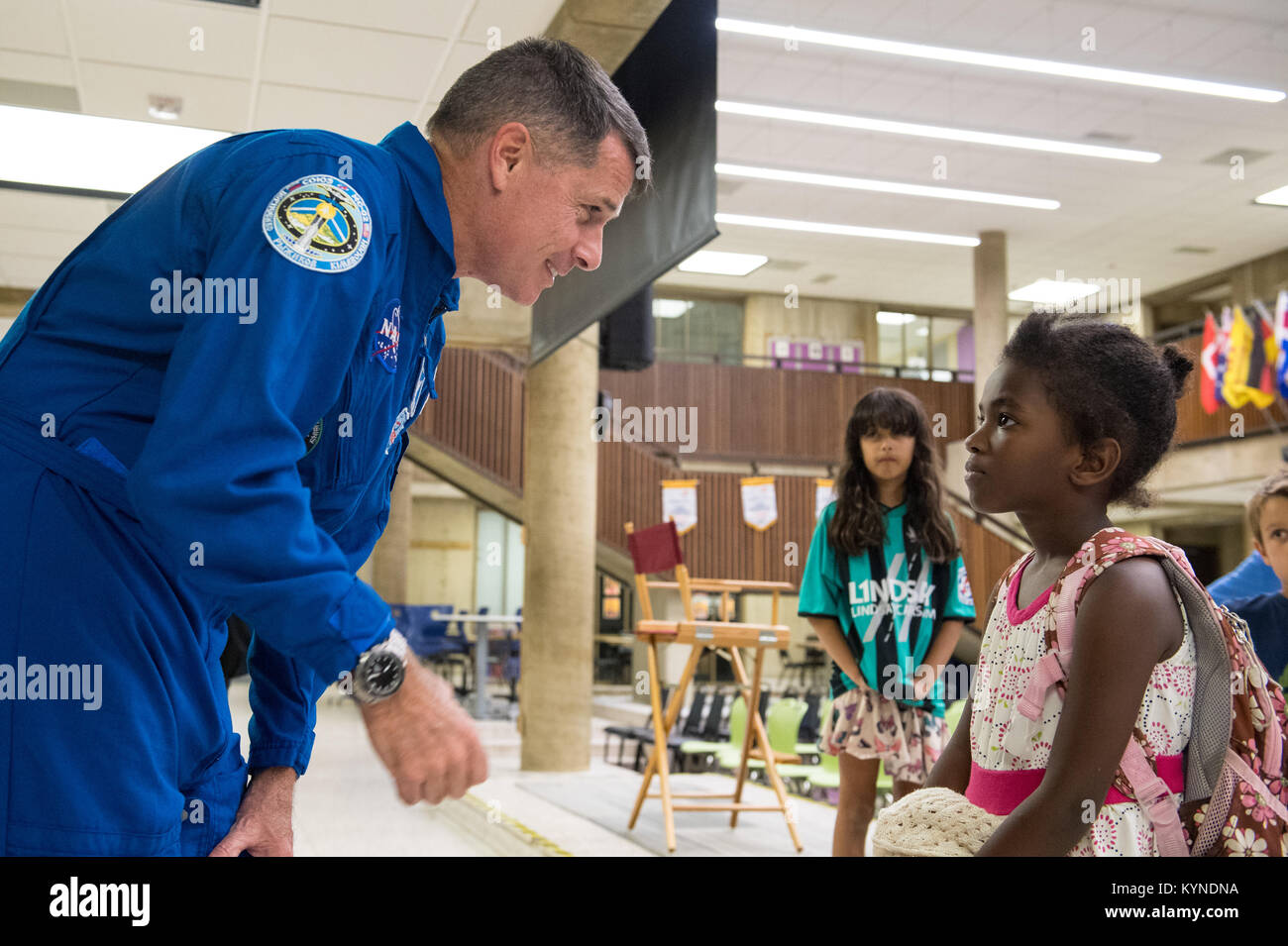 NASA astronaut Shane Kimbrough speaks to an audience member after giving a presentation about his time onboard the - Stock Image