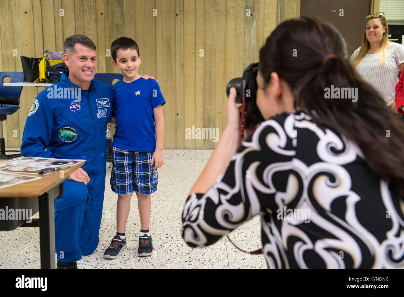 NASA astronaut Shane Kimbrough poses for a photo with an audience member after giving a presentation about his time - Stock Image
