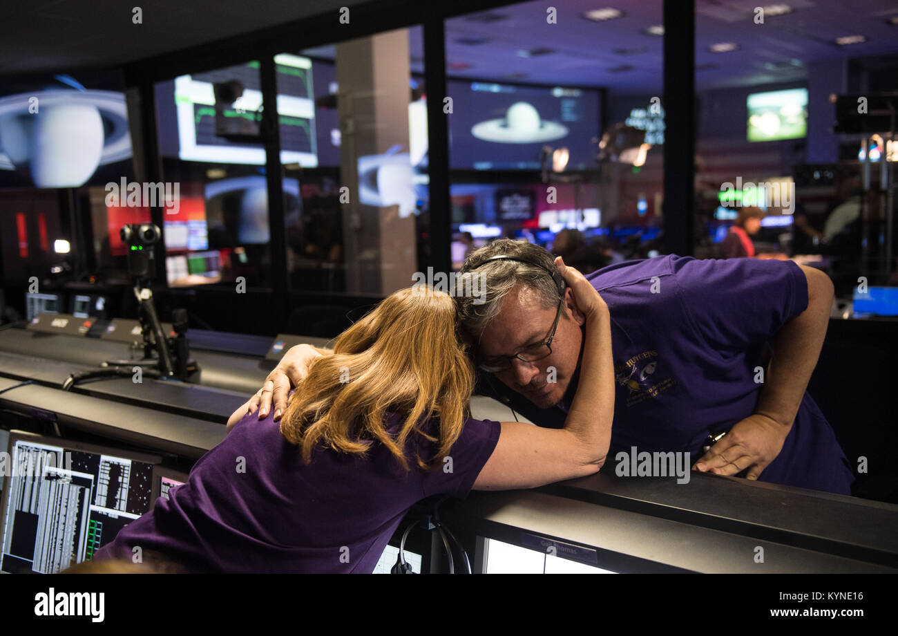 Cassini team members embrace after the spacecraft was deliberately plunged into Saturn, Friday, Sept. 15, 2017 at - Stock Image