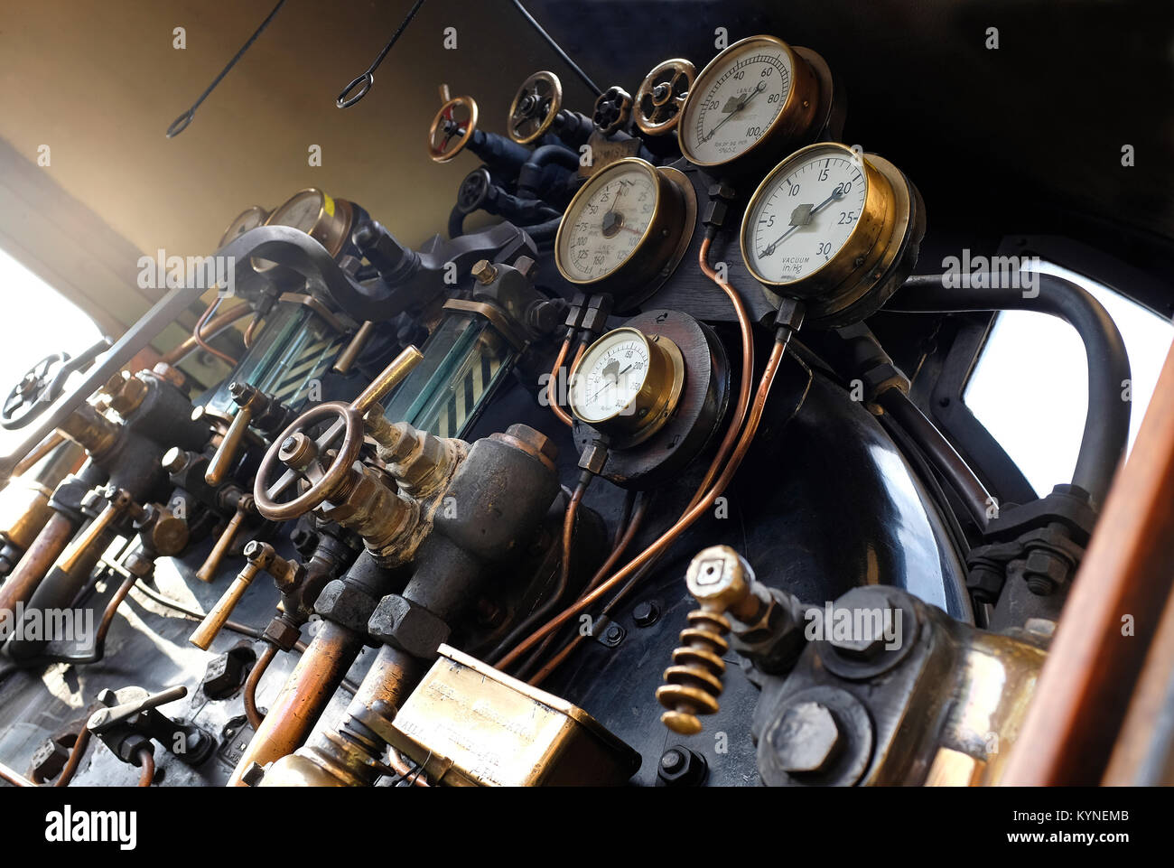 knobs, dials and levers on old steam train - Stock Image