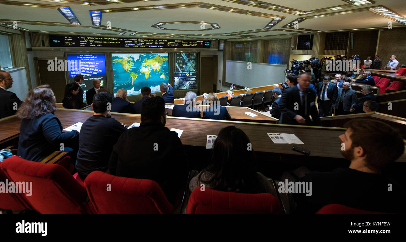 Friends and family members of the Soyuz MS-07 crew watch a live view of the International Space Station, as seen - Stock Image