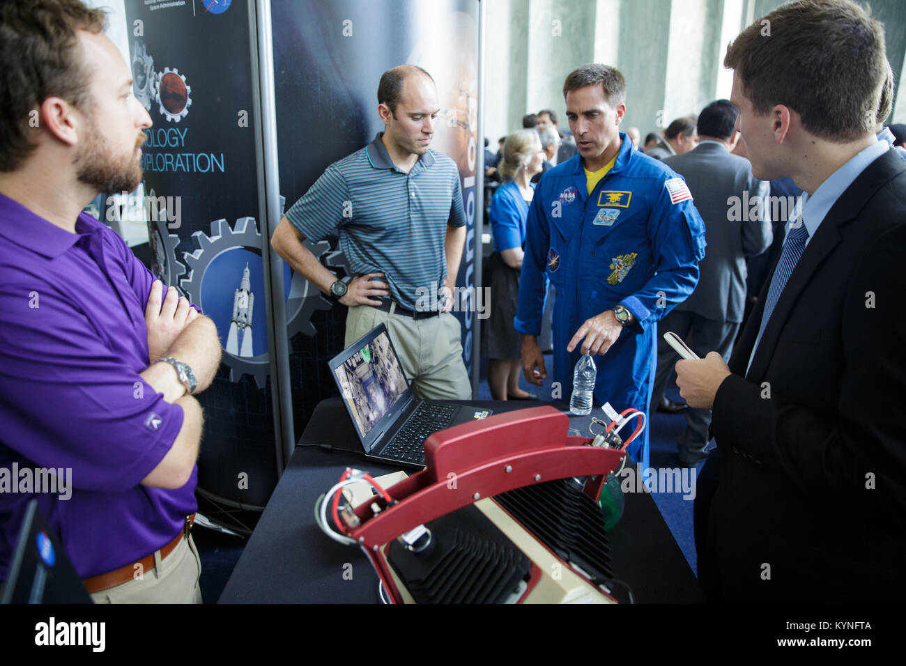 NASA astronaut Chris Cassidy views an exhibit on the Synchronized Position Hold, Engage, Reorient, Experimental - Stock Image