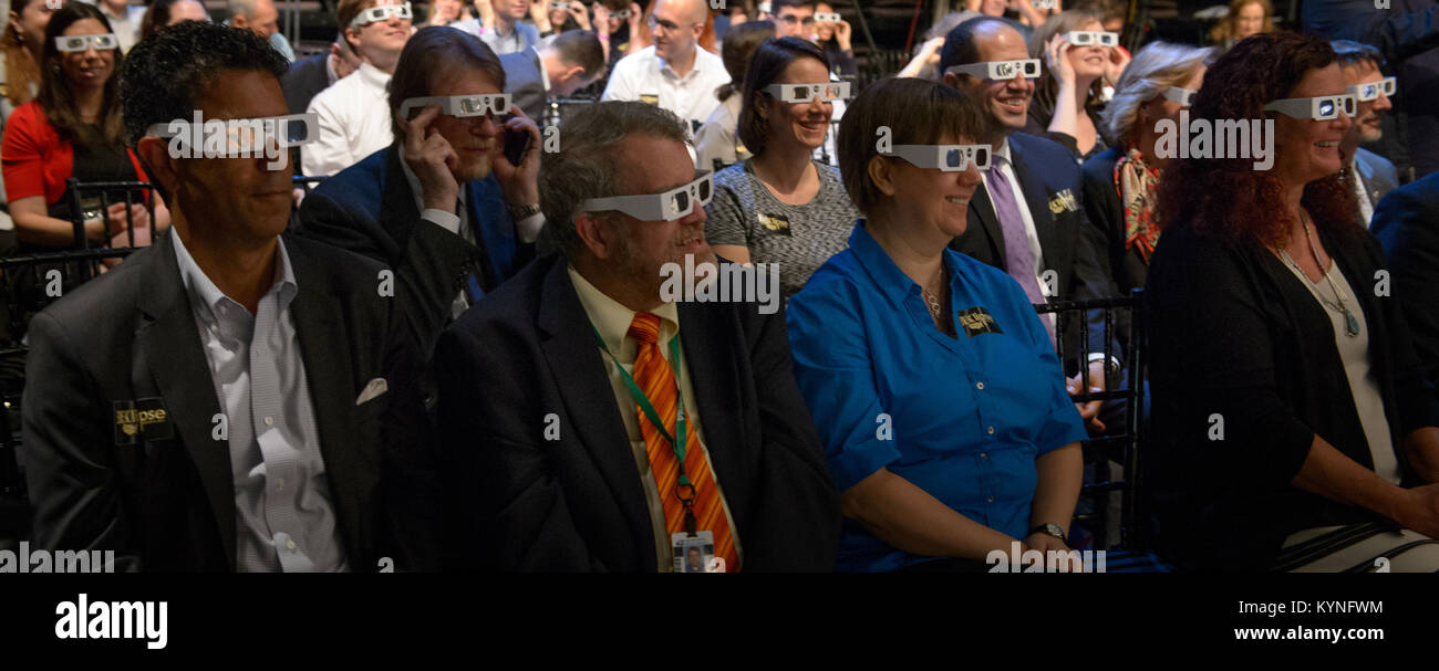 Audience members try on solar filter glasses during a total solar eclipse briefing, Wednesday, June 21, 2017 at - Stock Image