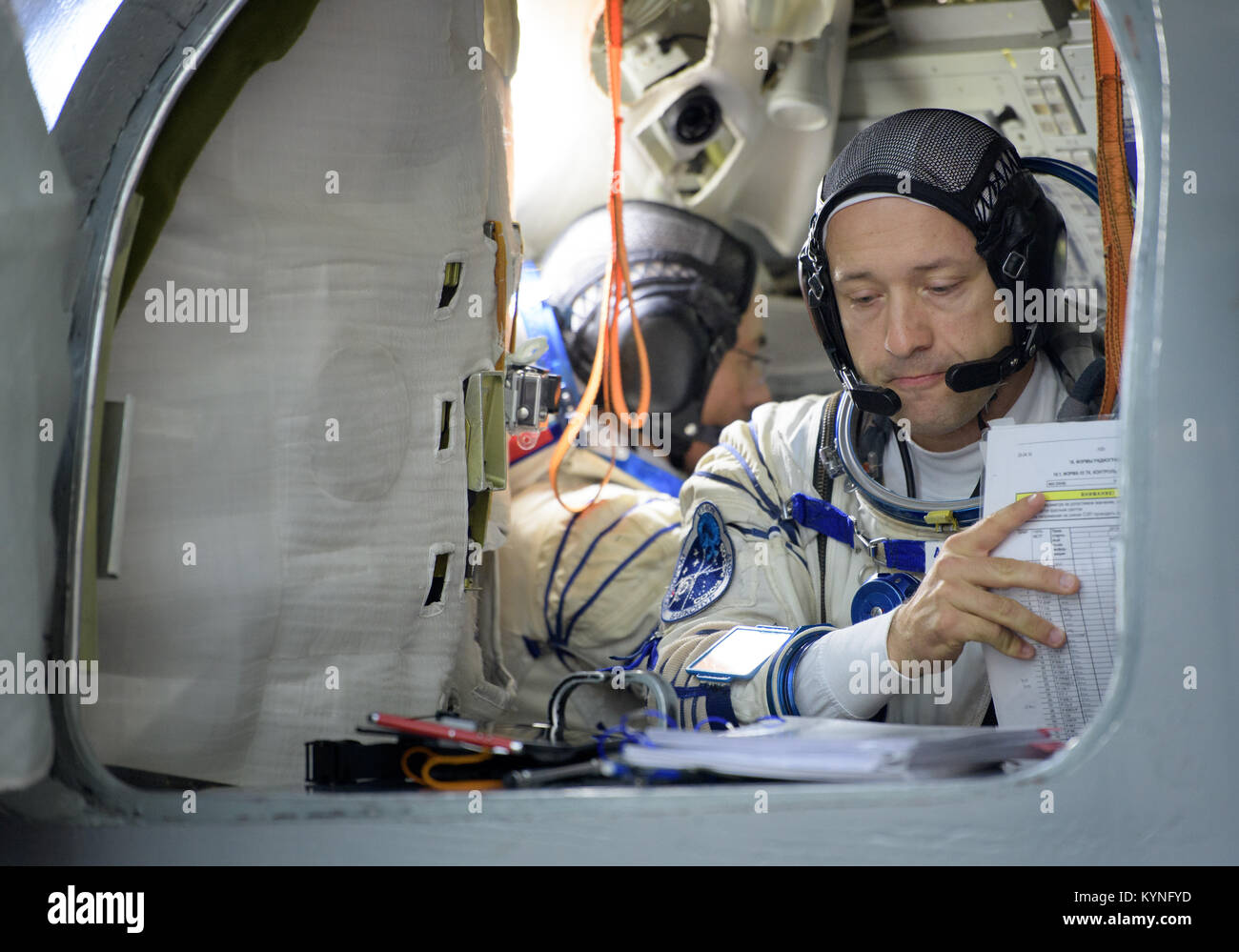 Expedition 52 backup crew member Alexander Misurkin of Roscosmos reviews his paperwork as he and Expedition 52 backup Stock Photo