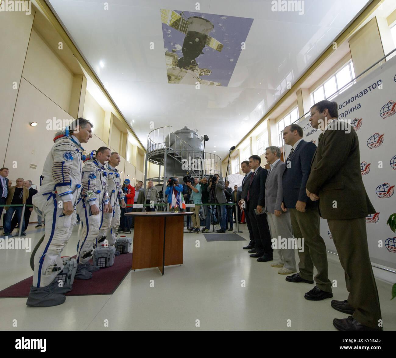 Expedition 52 flight engineers Paolo Nespoli of ESA, left, Sergey Ryazanskiy of Roscosmos, center, and Randy Bresnik - Stock Image