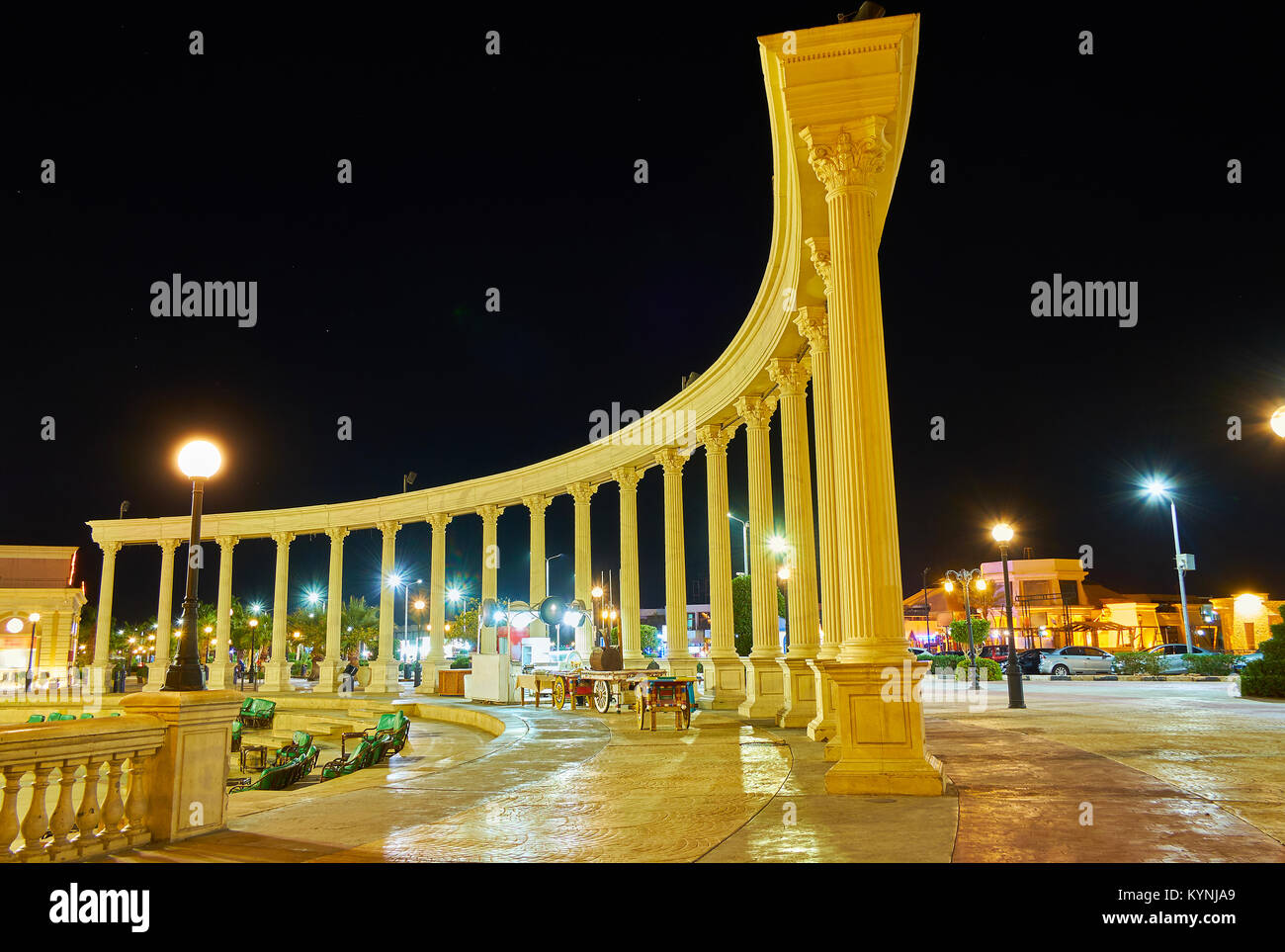 The brightly illuminated colonnade is the part of ensemble of Il Mercato shopping square in Hadaba district of Sharm - Stock Image