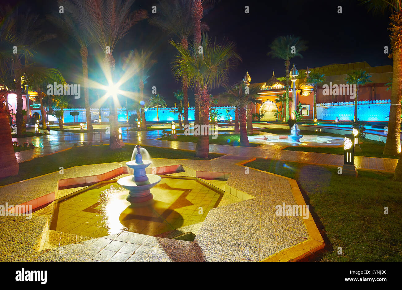The scenic fountain, decorated with al Quds star - famous Islamic symbol, located in garden at the Fantasia palace - Stock Image