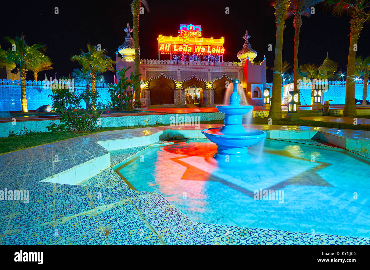 SHARM EL SHEIKH, EGYPT- DECEMBER 15, 2017: The scenic evening garden of Fantasia Palace (1001 nights palace) with - Stock Image