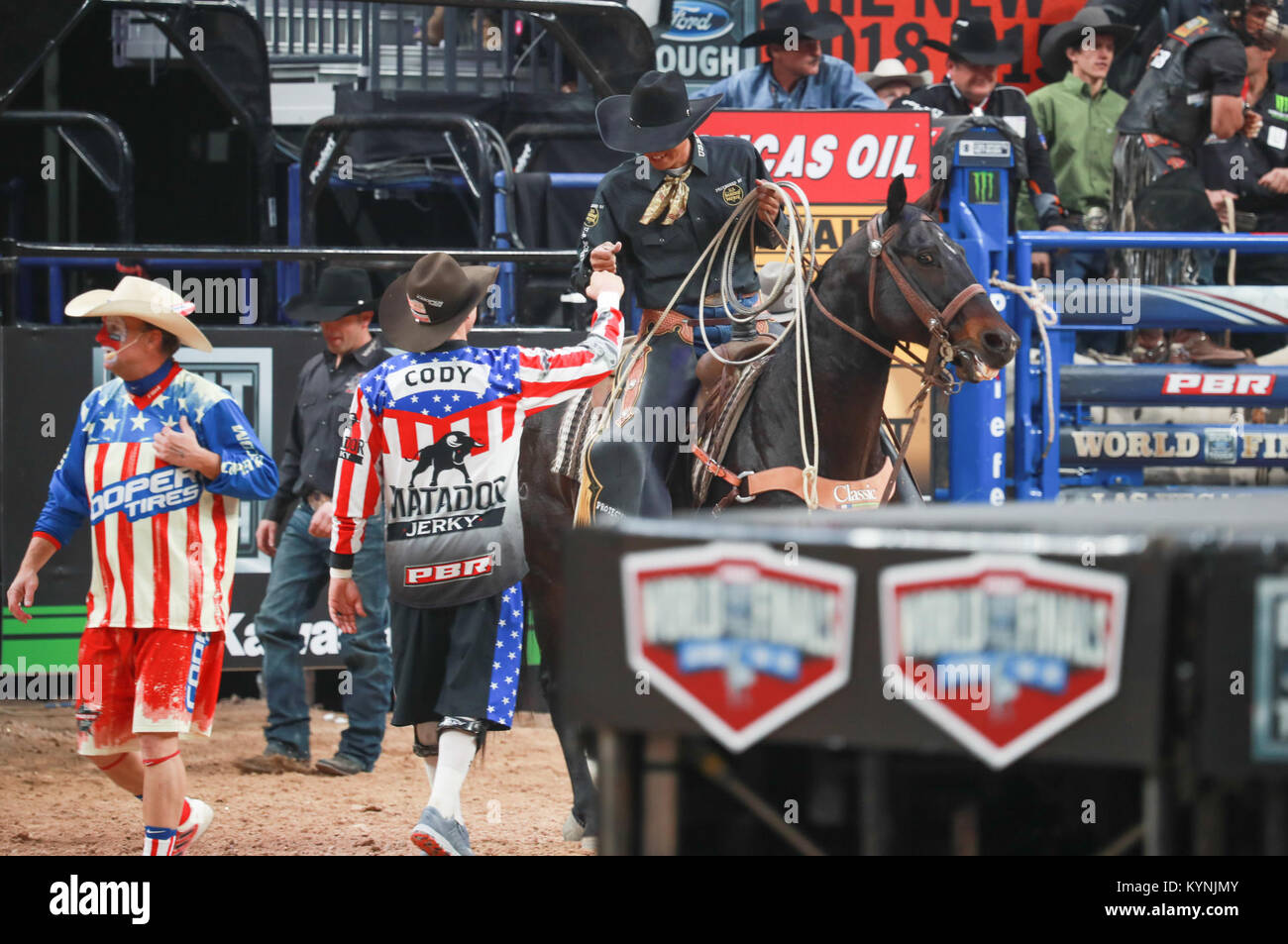 Rodeo clowns await action in the arena during the 2017 Professional